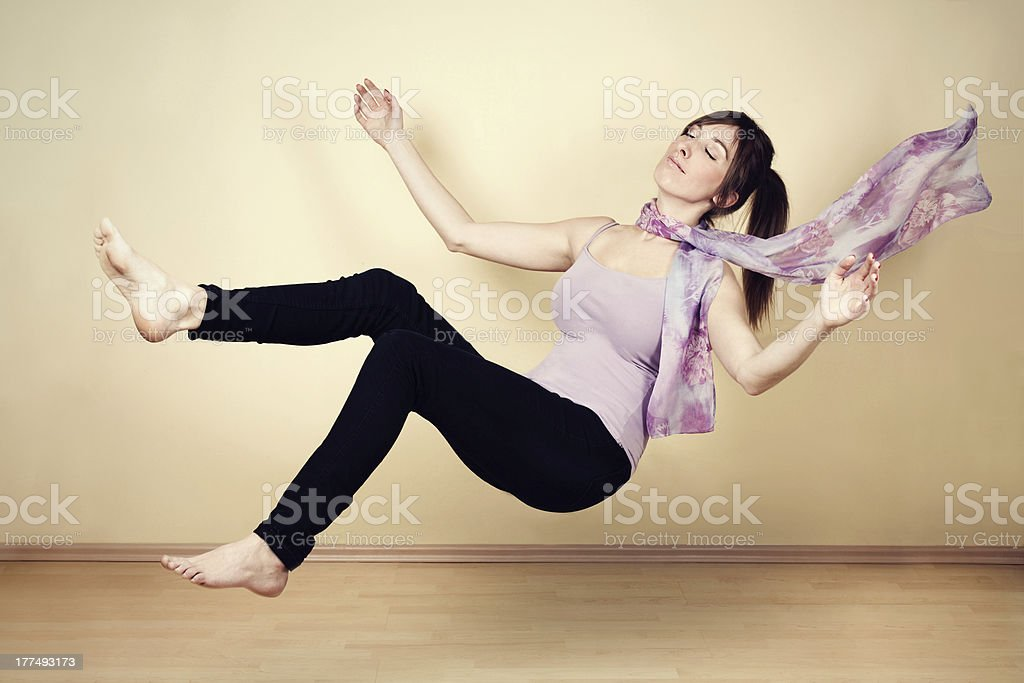 Young woman levitating stock photo
