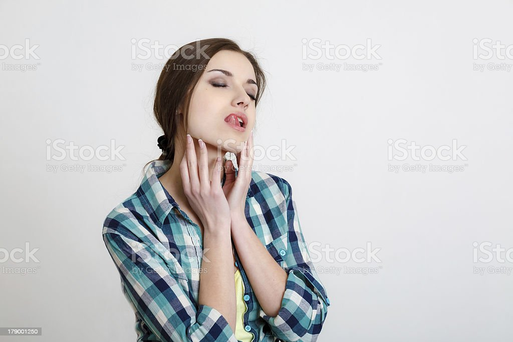 young woman licking her lips royalty-free stock photo