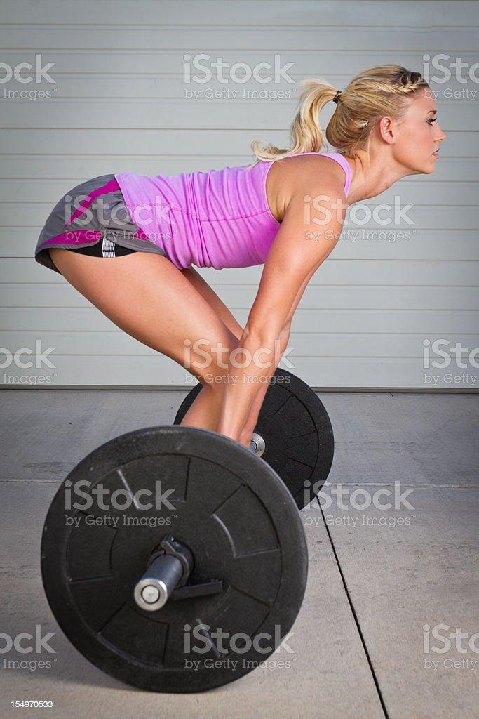 Young Woman Lifting Barbells royalty-free stock photo