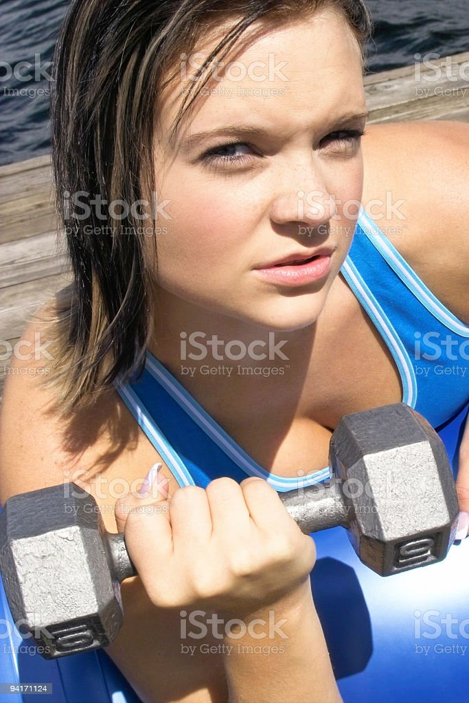 Young Woman Lifting Weights Outside royalty-free stock photo