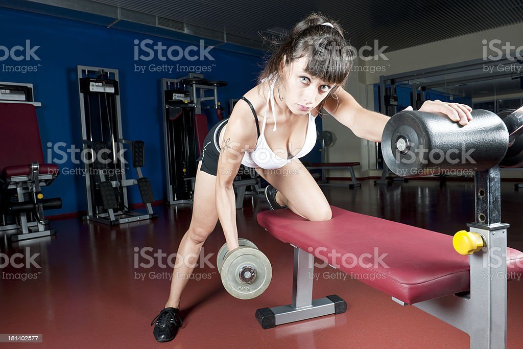 Young Woman Lifting Weights royalty-free stock photo