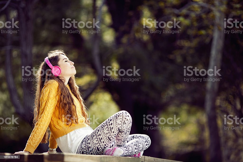 Young woman listen to music royalty-free stock photo