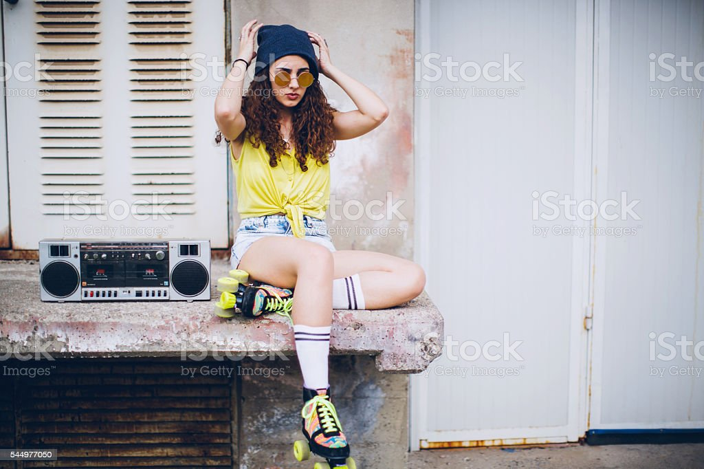 Young woman Listening Boombox stock photo