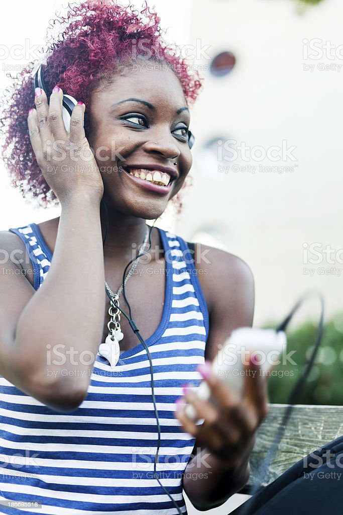 Young woman listening music from smartphone royalty-free stock photo