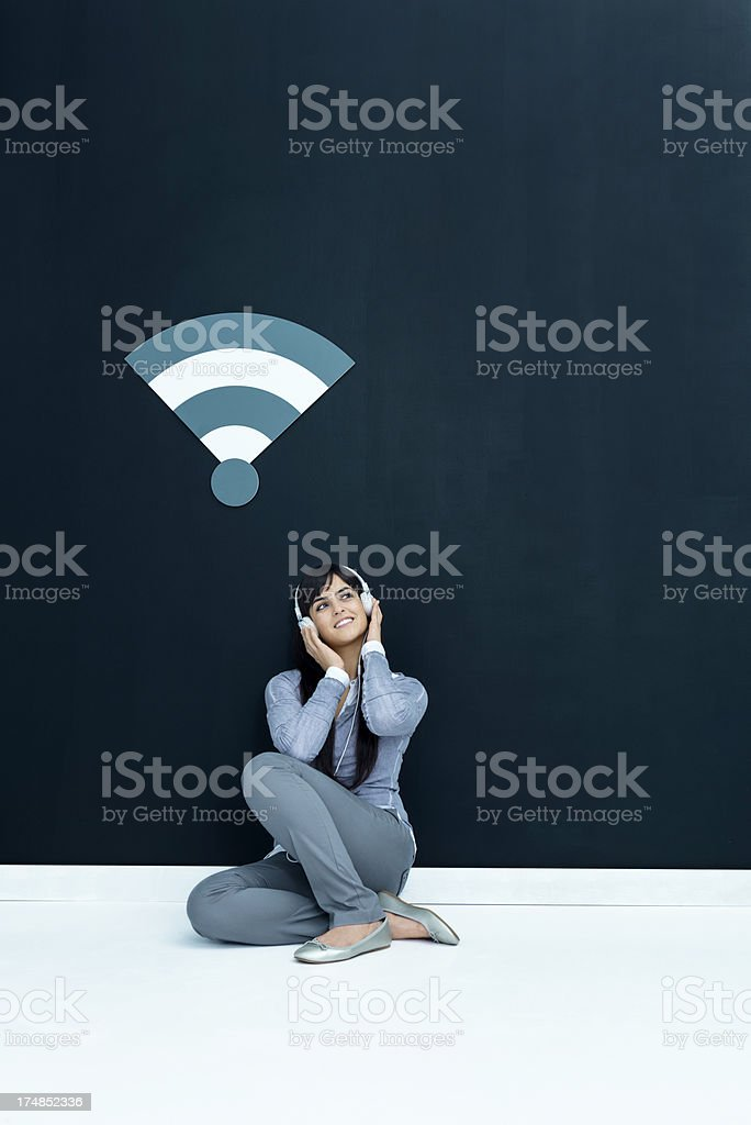 Young woman listening music through wifi royalty-free stock photo
