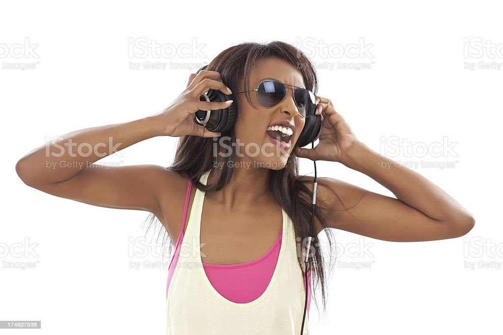 Young woman listening music with big headphones and singing royalty-free stock photo