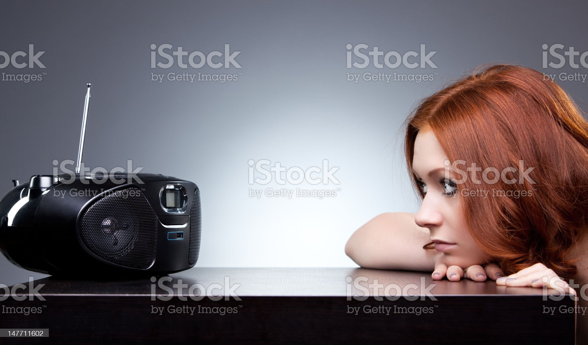 Young woman listening radio royalty-free stock photo