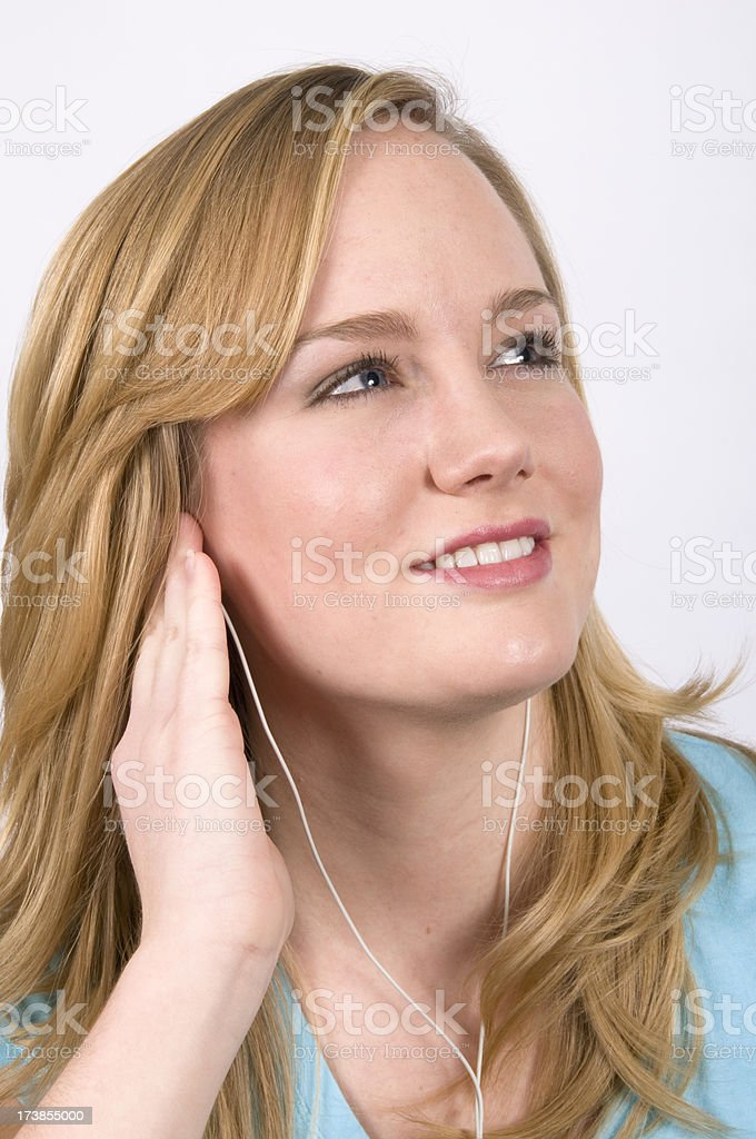 Young woman listening to mp3 player royalty-free stock photo