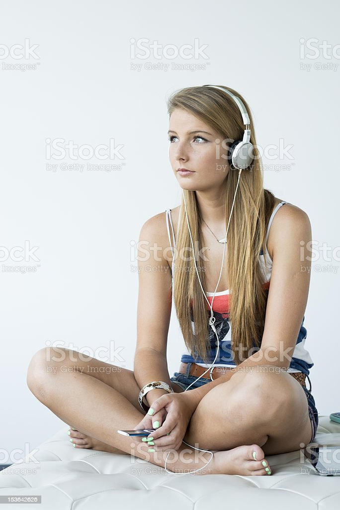 Young woman listhening to music in the headphones royalty-free stock photo