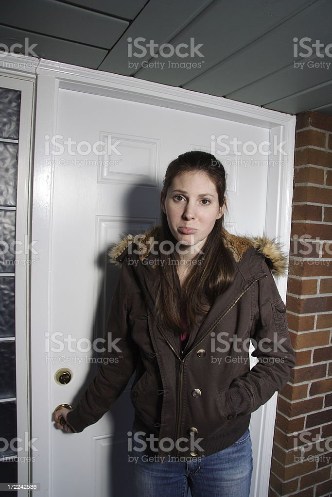 young woman locked out of house royalty-free stock photo
