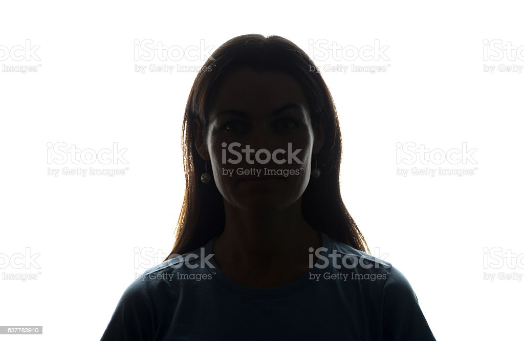 Young woman look ahead with flowing hair - horizontal silhouette stock photo