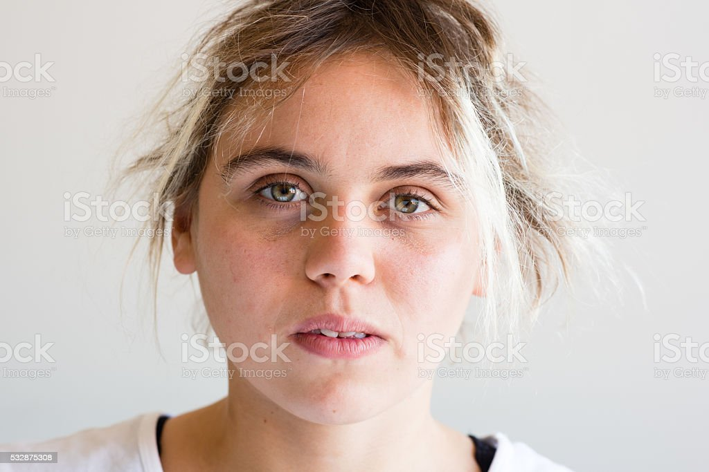 Young woman looking anxious stock photo