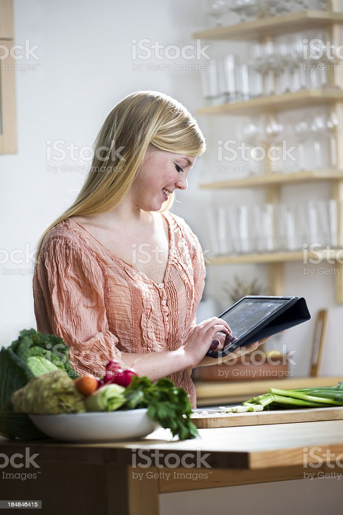 Young woman looking at a  Recipe online royalty-free stock photo