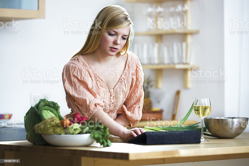 Young woman looking at a  Recipe online stock photo