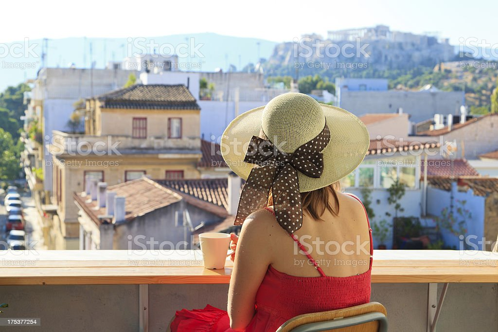 young woman looking at Acropolis, travel concept stock photo