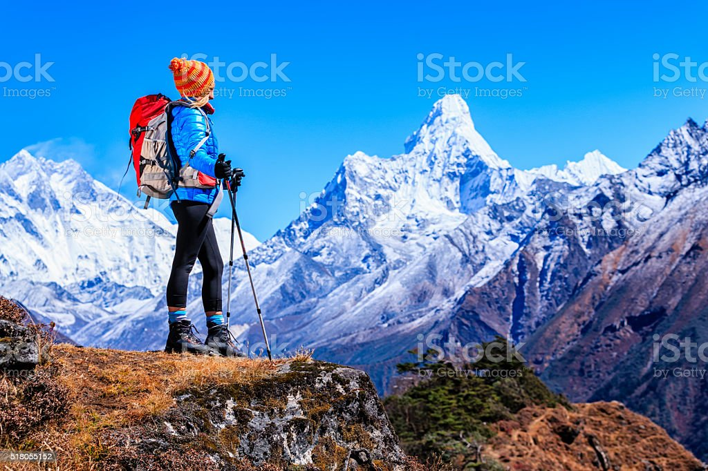 Young woman looking at Ama Dablam, Mount Everest National Park stock photo