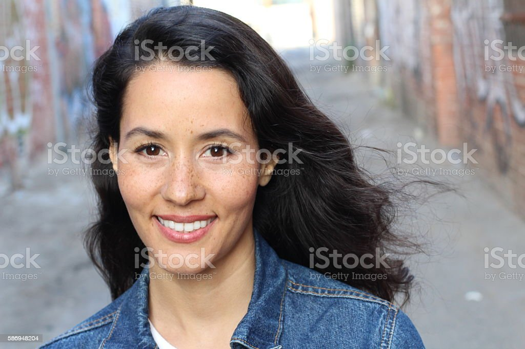 Young woman looking at camera in the city stock photo