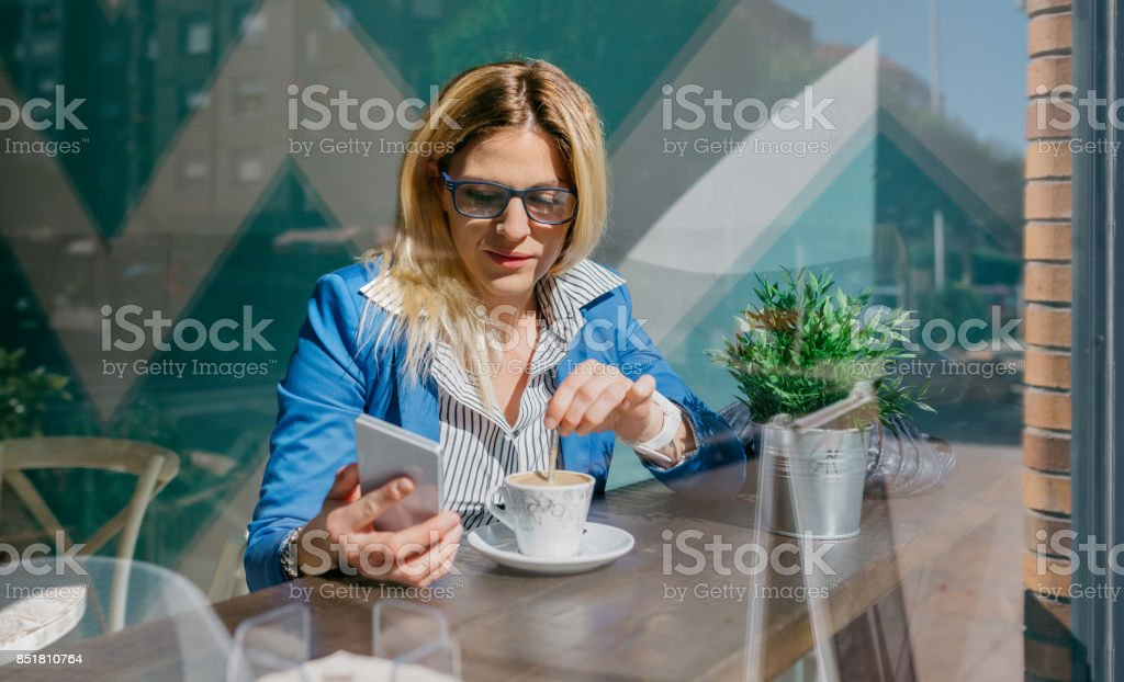 Young woman looking at cellphone stock photo