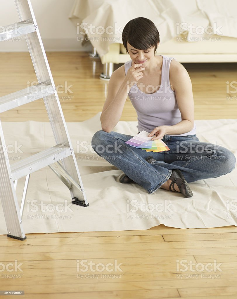 Young Woman Looking at Color Swatches on Floor royalty-free stock photo