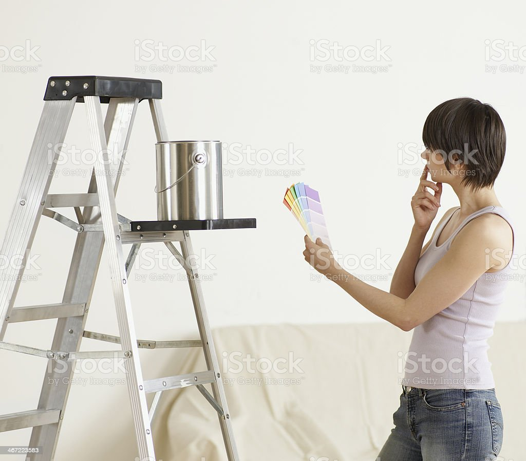 Young Woman Looking at Color Swatches royalty-free stock photo