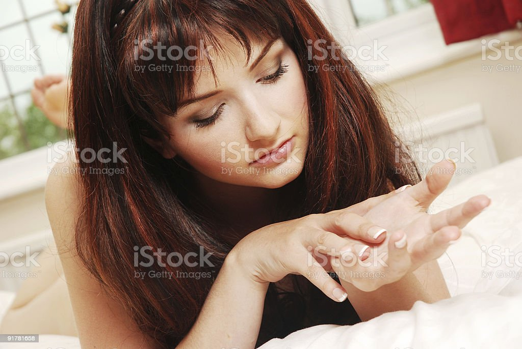 Young woman looking at her hands stock photo
