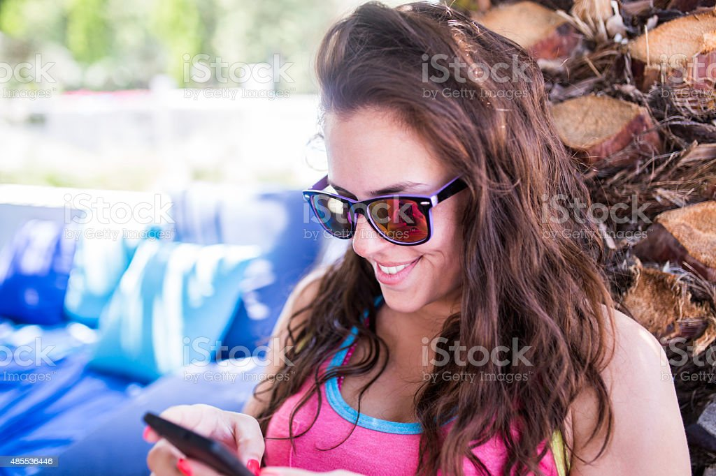 Young woman looking at her phone stock photo