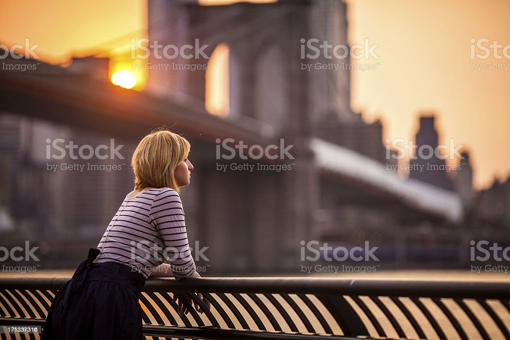 Young woman looking at New York City stock photo