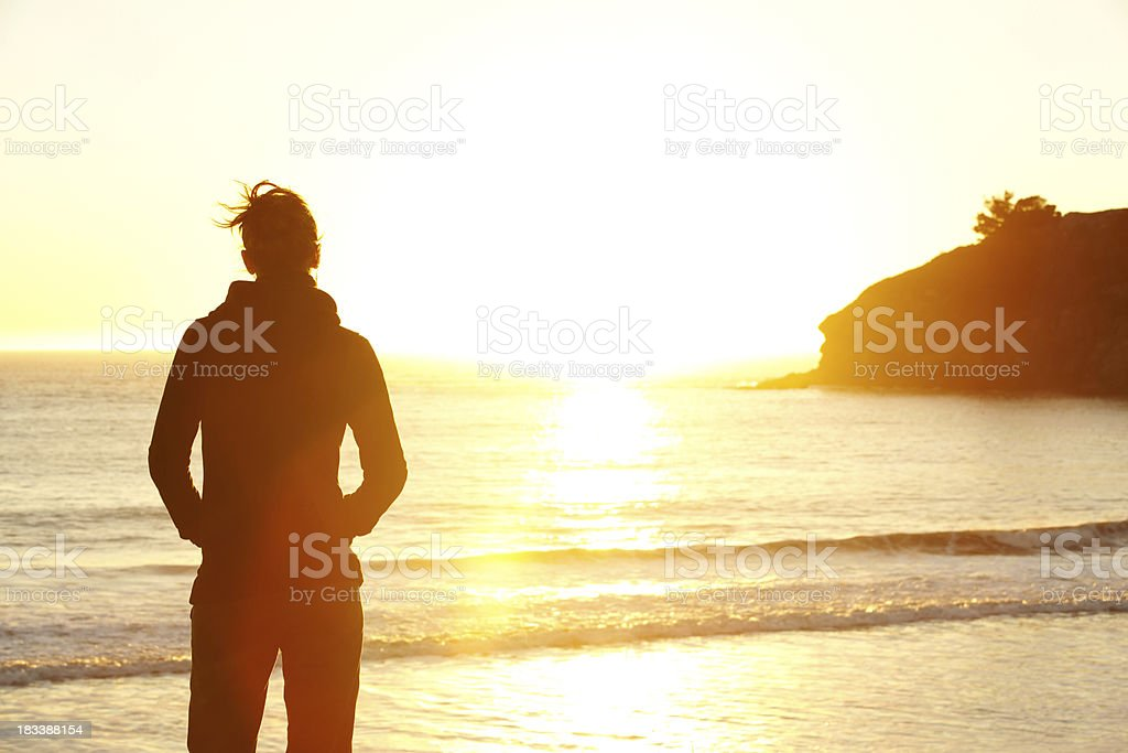 Young woman looking at sunset royalty-free stock photo