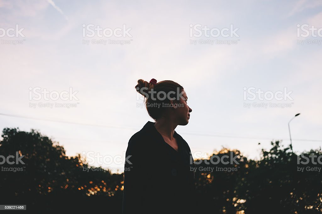 Young woman looking at sunsetce stock photo