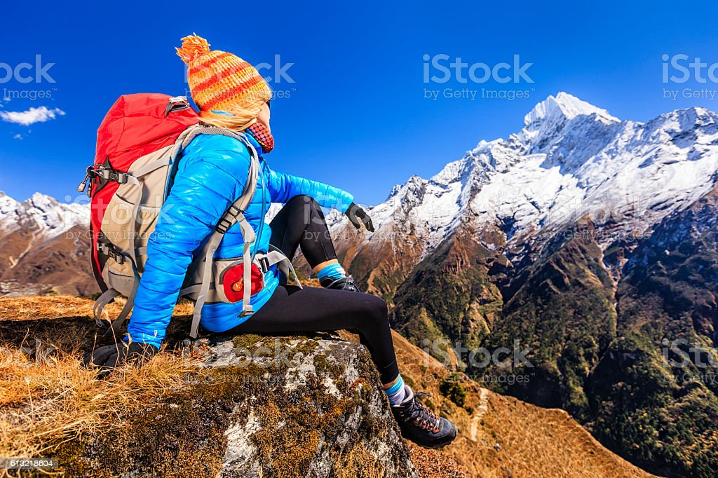 Young woman looking at Thamserku, Mount Everest National Park stock photo