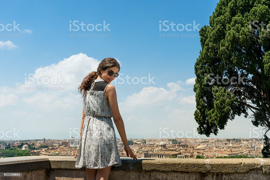 Young woman looking at the camera, in  back  skyline  Rome stock photo