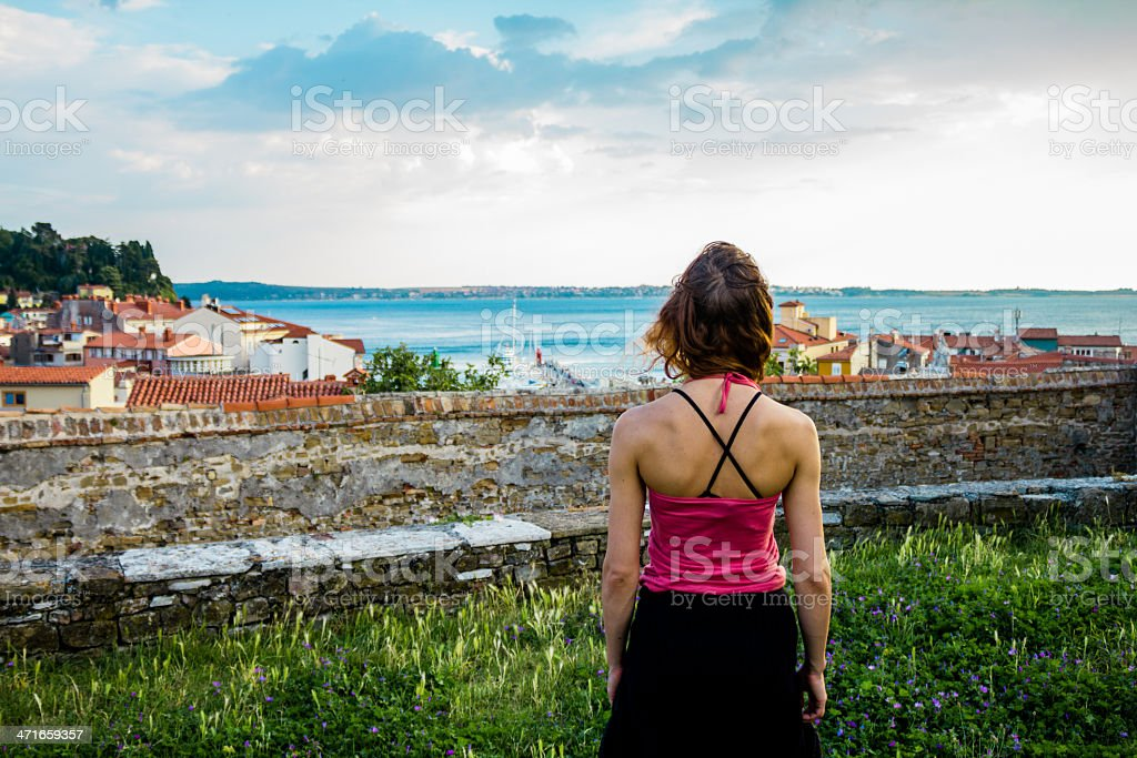 Young woman looking at the sea small village royalty-free stock photo