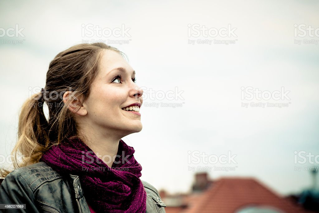 young woman looking at the sky royalty-free stock photo