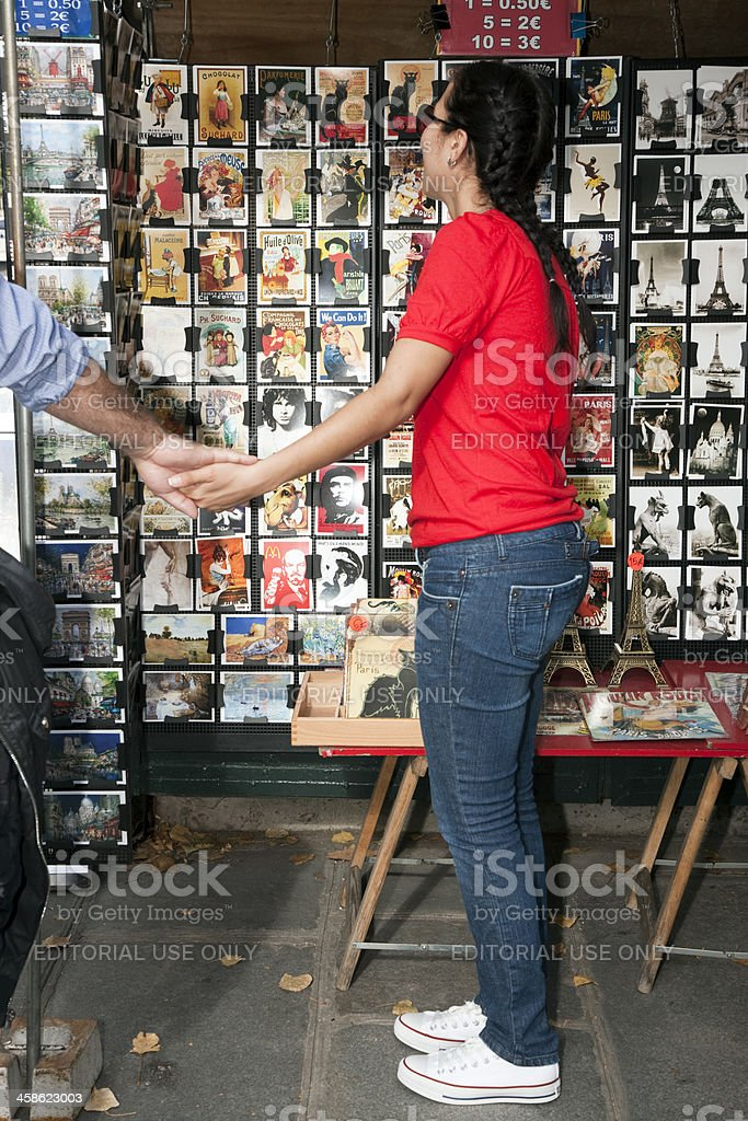 Young Woman looking at Vintage Posters and Advetisements royalty-free stock photo