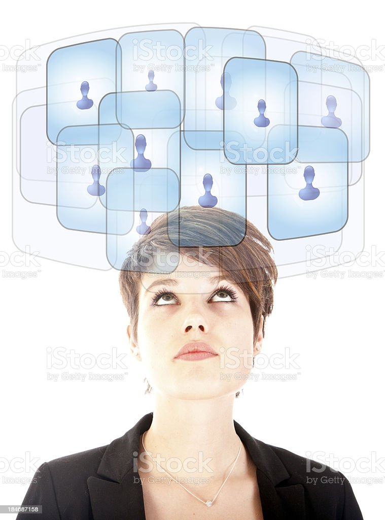 Young woman looking at virtual friends stock photo
