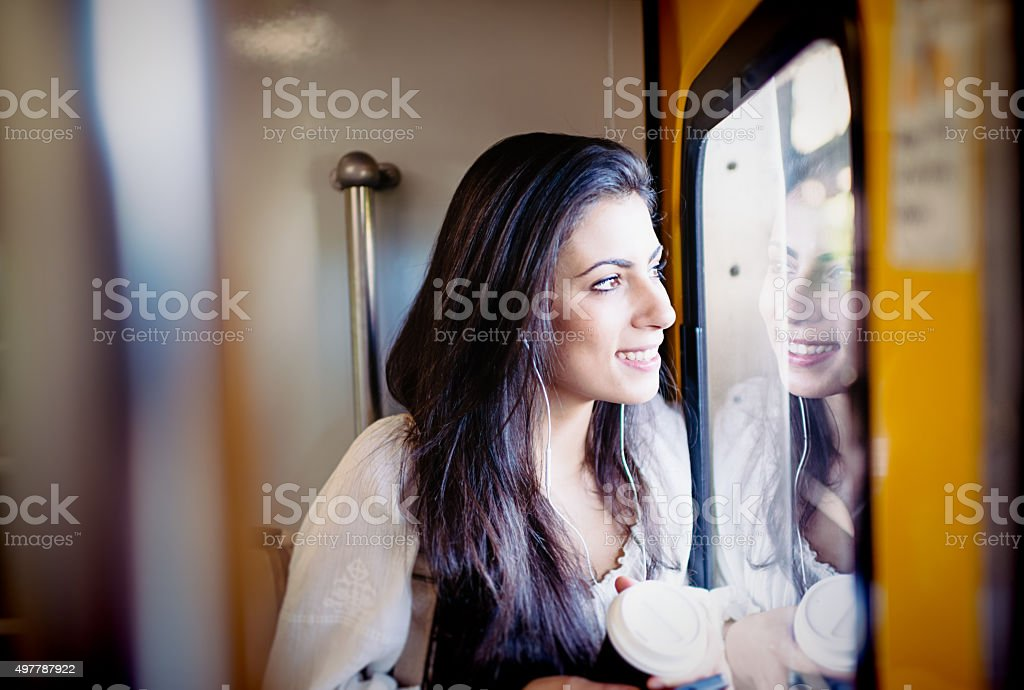 Young woman looking at window in subway train stock photo