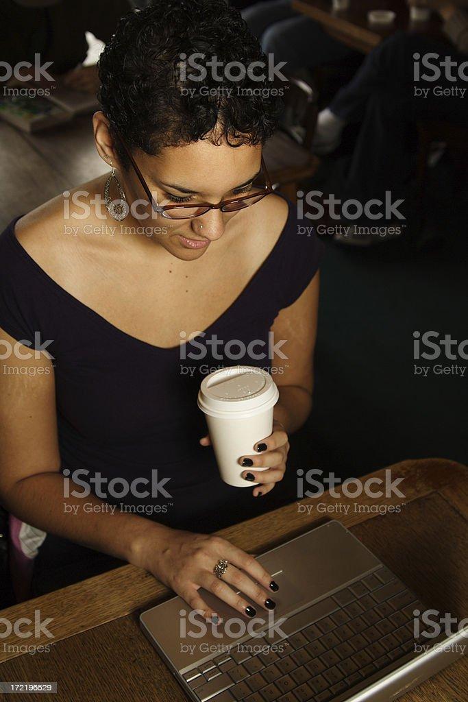 young woman looking down at computer royalty-free stock photo