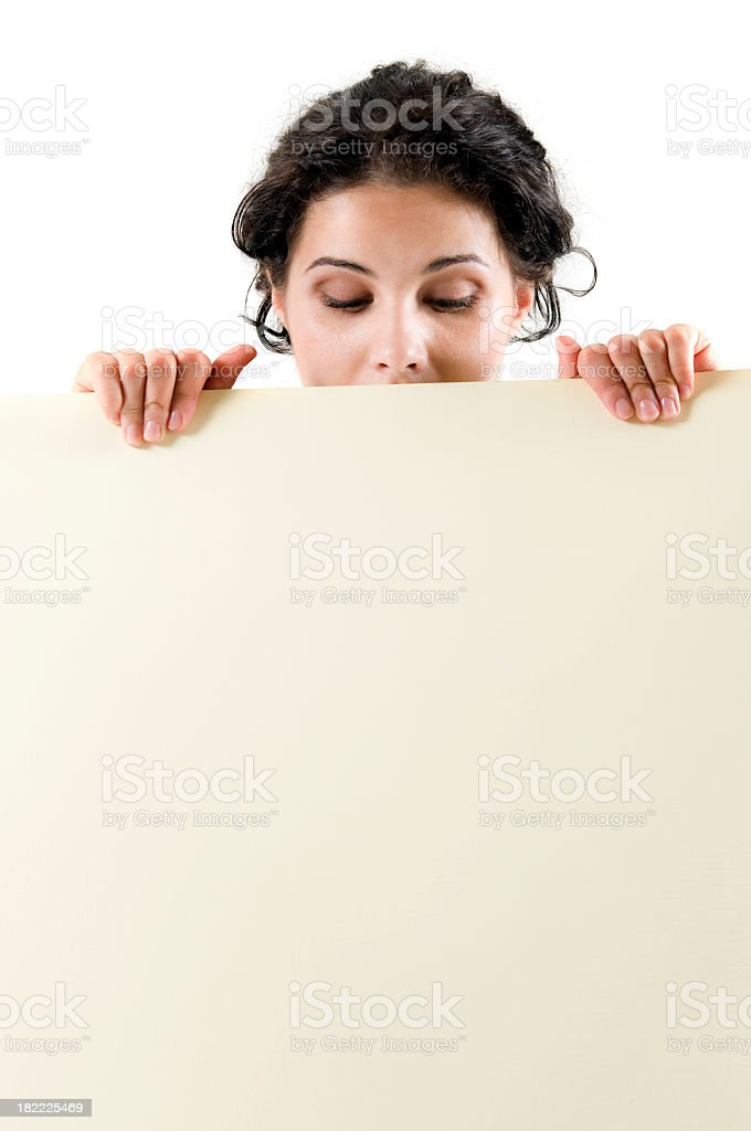 Young woman looking down at the signboard royalty-free stock photo