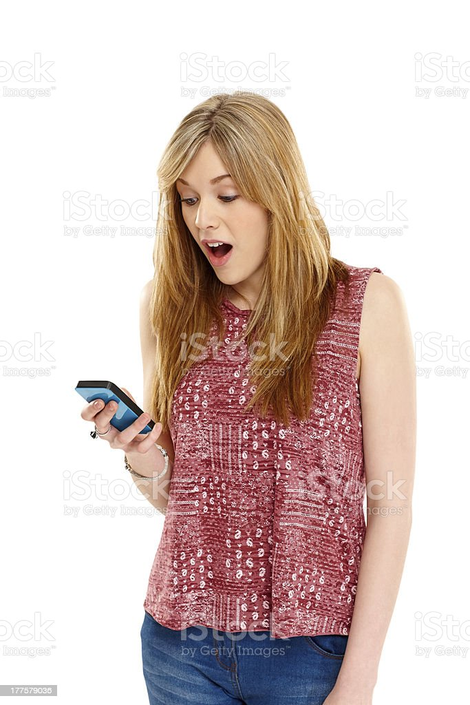 Young woman looking excited while texting royalty-free stock photo