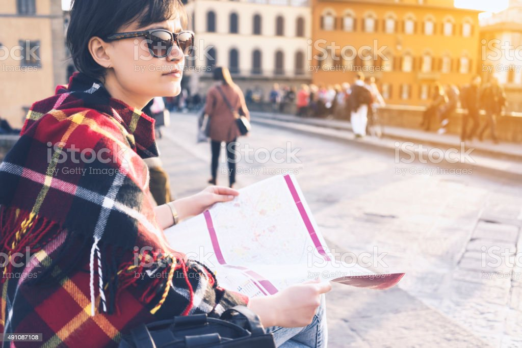 Young woman looking for direction in the city stock photo