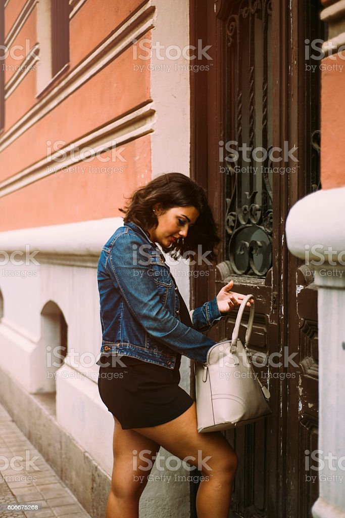 Young woman looking for the keys stock photo