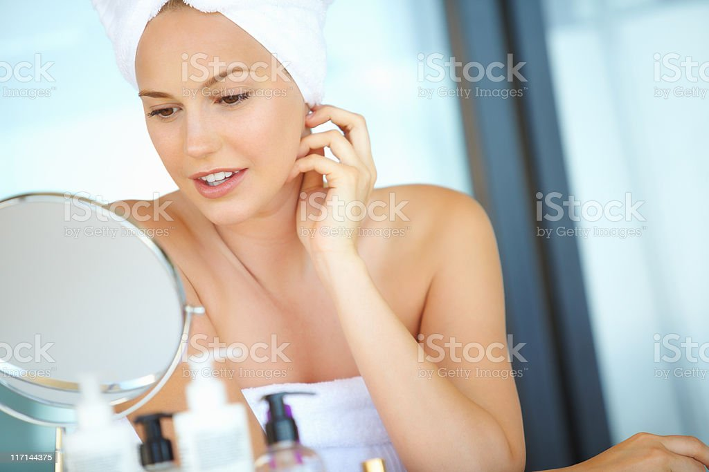 Young woman looking in the mirror royalty-free stock photo