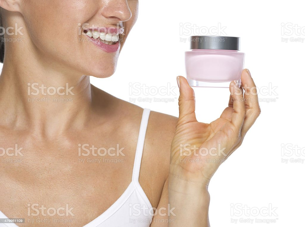 Young woman looking on cream bottle. Closeup royalty-free stock photo