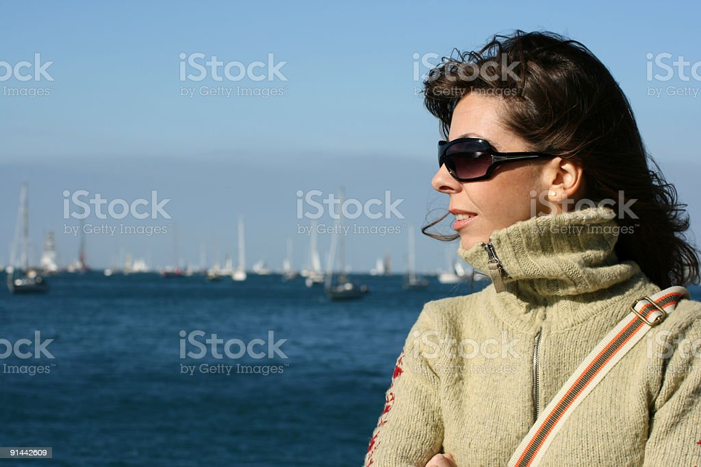 Young woman looking regatta royalty-free stock photo