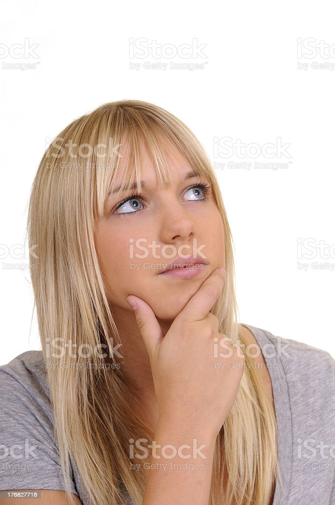 young woman looking thoughtful royalty-free stock photo
