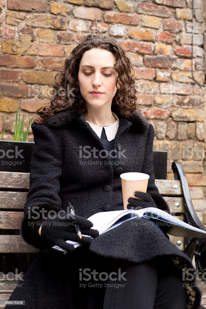 young woman looking through a notebook royalty-free stock photo