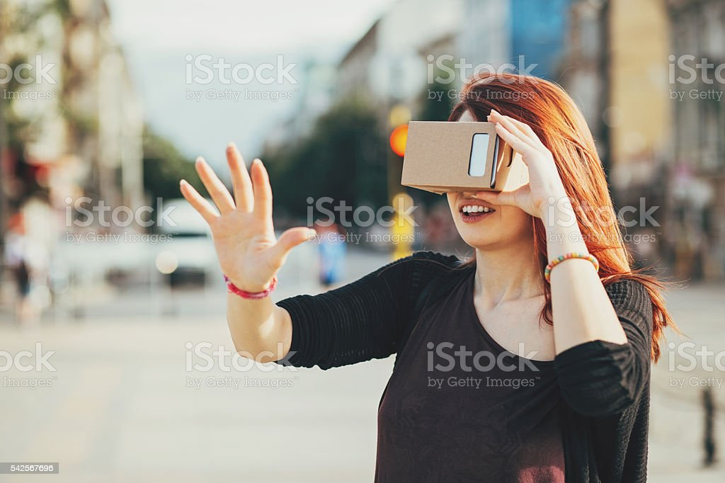 Young woman looking through a reality simulatop stock photo
