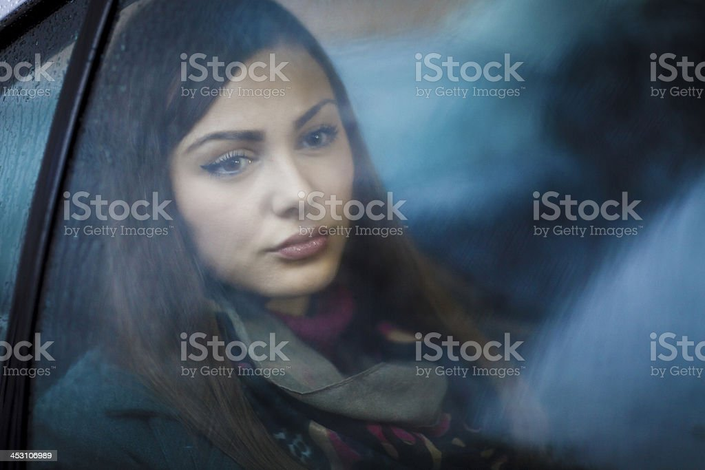 Young woman looking through car window royalty-free stock photo