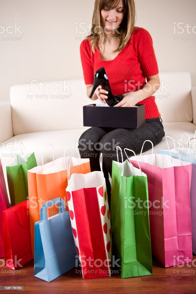 Young Woman Looking through Shopping Bags royalty-free stock photo