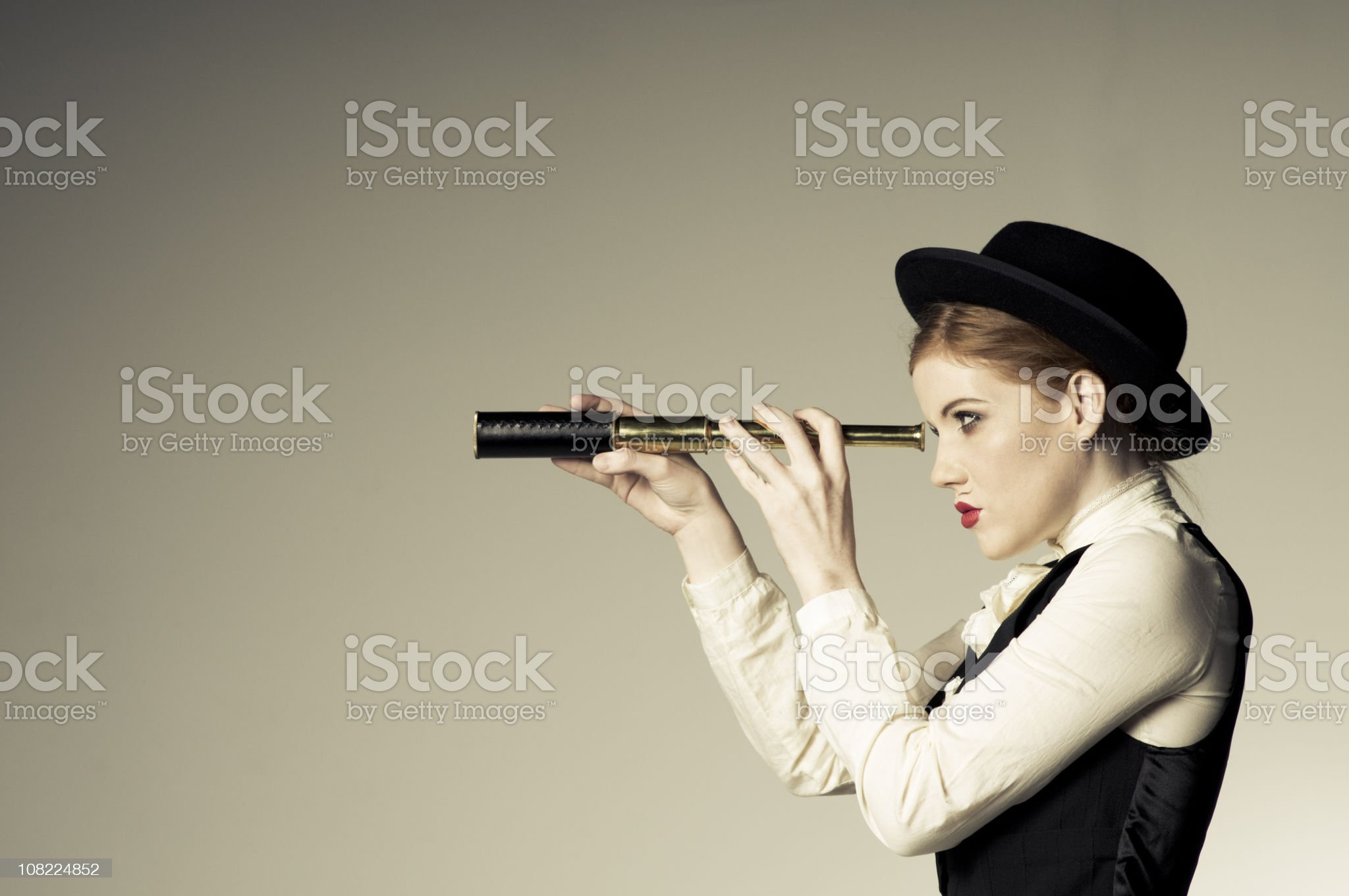Young Woman Looking Through Telescope royalty-free stock photo